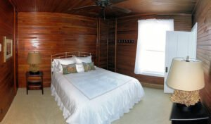 The Cottage Room -- Located on the Inn's second story, the Cottage Room is the newest addition to Grey Havens. It is a quaint and cozy room on the back side of the Inn with a queen bed and private bath. This room has no ocean view.