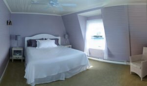 The Harbor Suite -- The Harbor Suite at the Grey Havens Inn is an oceanfront room with a queen bed, private bath, and a lovely ocean view.