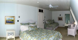 The Reid Room - View 1 -- Named after the original owner of the Grey Havens Inn, the Reid Room is a larger room on the back corner of the inn with a king bed, as well as a twin bed, private bath and a side view Harmon's Harbor.