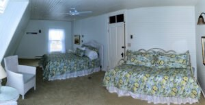 The Reid Room - View 2 -- Named after the original owner of the Grey Havens Inn, the Reid Room is a larger room on the back corner of the inn with a king bed, as well as a twin bed, private bath and a side view Harmon's Harbor.