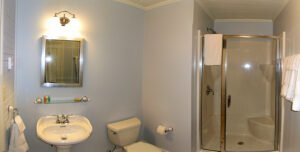 The Tides Room Bath -- Private bath with shower. The Tides at Grey Havens.