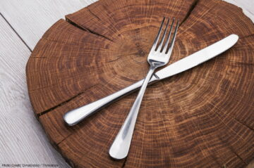 fork and knife on a wooden stand